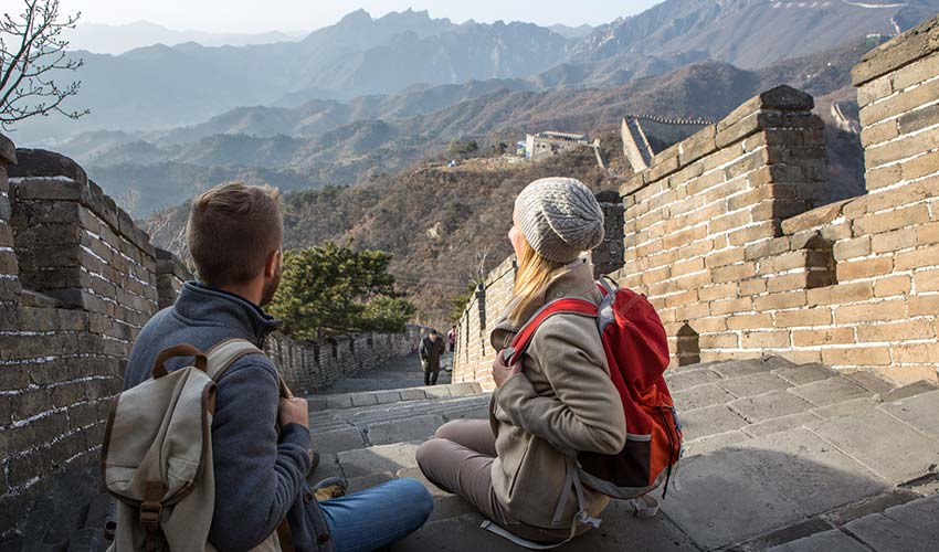 young couple hiking the great wall