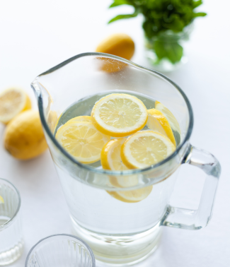 a jar of water with slices of lemon