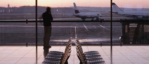 a person sitting on a tarmac at an airport