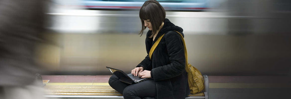 Girl with laptop at station