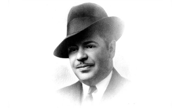 a young man wearing a hat posing for the camera