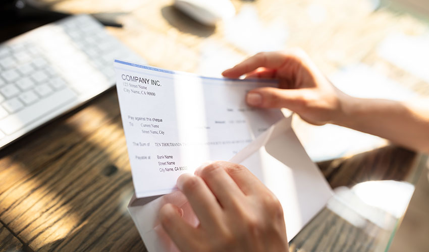 businessperson opening envelope