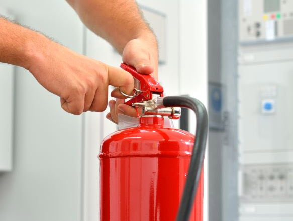 Man testing fire extinguisher